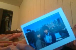 @iamsamir Holding Postcard of @iamsamir